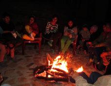people enjoying the bonfire